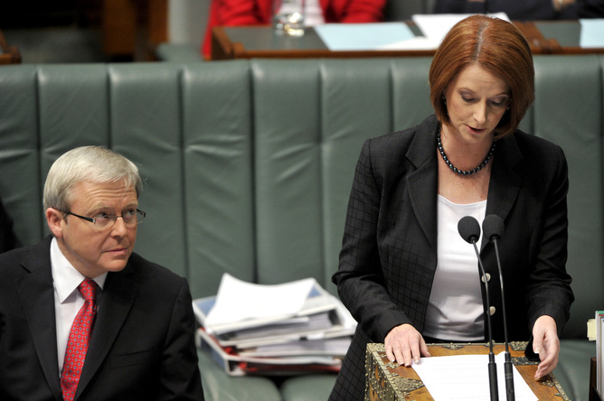 **FILE** A June 16, 2010 file photo of Prime Minister Kevin Rudd (left) listening to deputy prime minister Julia Gillard during House of Representatives question time in Canberra. Kevin Rudd will be sworn in as prime minister after winning a vote on the federal Labor leadership 57-45 over Julia Gillard on Wednesday night. (AAP Image/Alan Porritt, File) NO ARCHIVING